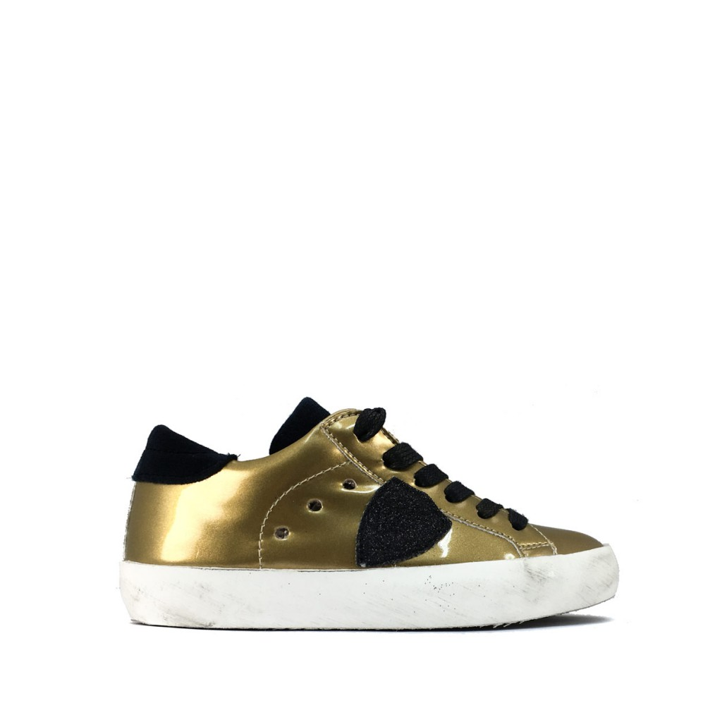 09c3b1330966f Philippe Model - Low gold sneaker with black accents